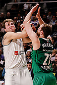 22nd March 2018, Wizink Centre, Madrid, Spain; Turkish Airlines Euroleague Basketball, Real Madrid versus Zalgiris Kaunas; Luka Doncic (Real Madrid Baloncesto) pulls the ball back from contact with Arturas Milaknis (Zalgiris Kaunas)