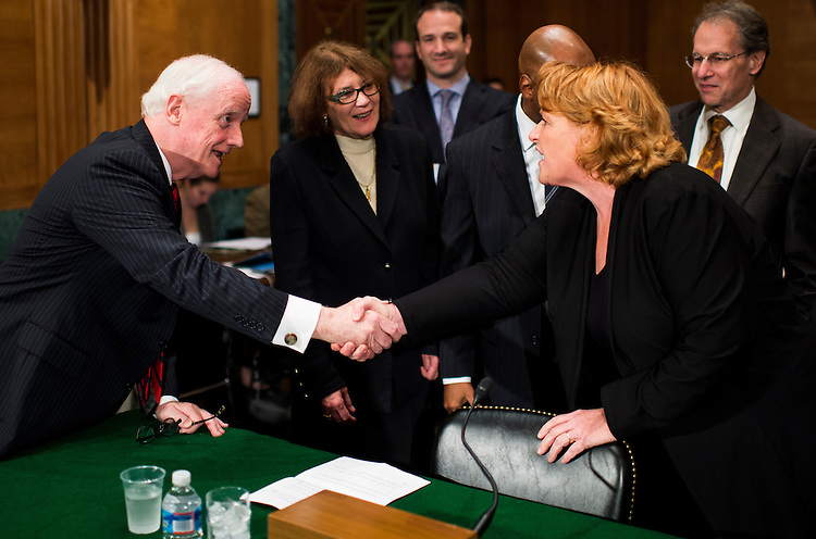 "UNITED STATES - OCTOBER 10: Frank Keating, president and CEO of the American Bankers Association, shakes hands with Sen. Heidi Heitkamp, D-N. Dak., before the start of the Senate Banking, Housing and Urban Affairs Committee hearing on ""Impact of a Default on Financial Stability and Economic Growth"" on Thursday, Oct. 10, 2013. (Photo By Bill Clark/CQ Roll Call)"