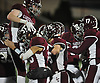 Garden City teammates celebrate after their 33-0 win over Mepham in the Nassau County Conference II varsity football final at Hofstra University on Friday, Nov. 17, 2017.