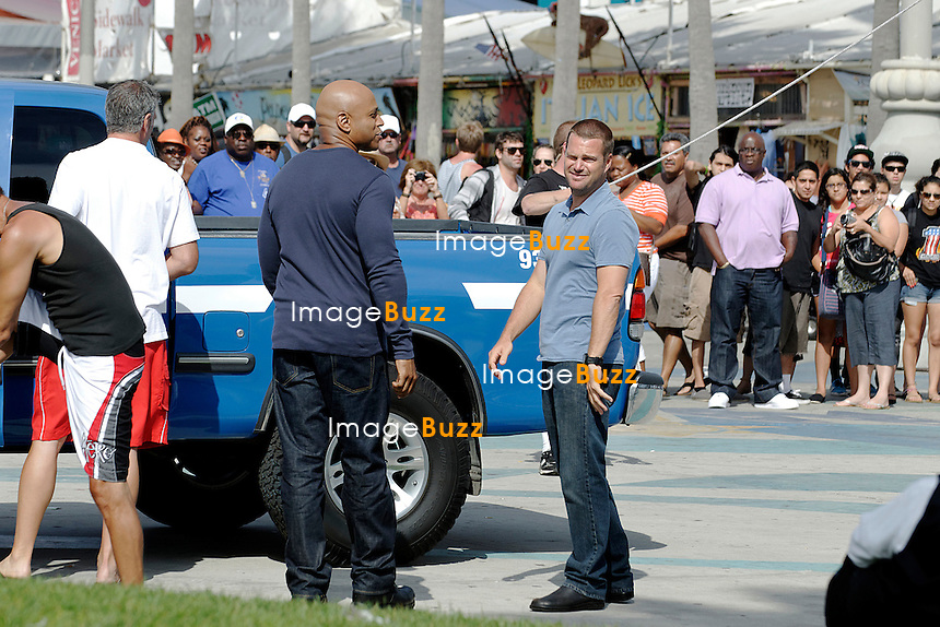 LL Cool J and Chris O'Donnell during the set of NCIS Los Angeles,  filming in Venice Beach, California. Los Angeles, July 23, 2012.