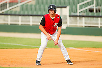 Mark Haddow (21) of the Kannapolis Intimidators takes his lead off of first base against the Rome Braves at CMC-Northeast Stadium on August 5, 2012 in Kannapolis, North Carolina.  The Intimidators defeated the Braves 9-1.  (Brian Westerholt/Four Seam Images)