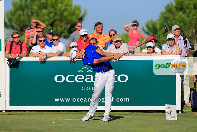Matteo Manassero (ITA) tees off the 15th tee during Thursday's Round 1 of the 2013 Portugal Masters held at the Oceanico Victoria Golf Club. 10th October 2013.<br /> Picture: Eoin Clarke www.golffile.ie