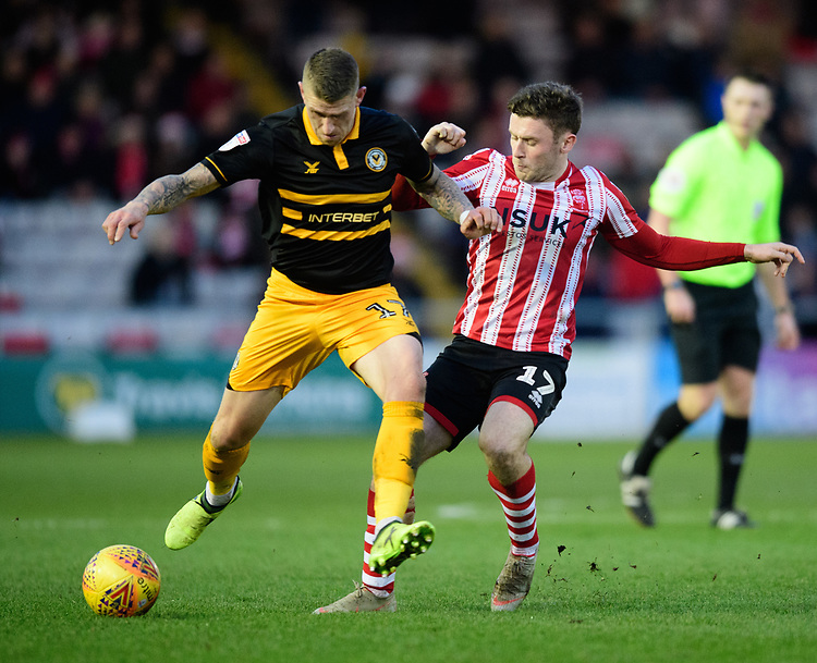 Newport County's Scot Bennett shields the ball from Lincoln City's Shay McCartan<br /> <br /> Photographer Chris Vaughan/CameraSport<br /> <br /> The EFL Sky Bet League Two - Lincoln City v Newport County - Saturday 22nd December 201 - Sincil Bank - Lincoln<br /> <br /> World Copyright © 2018 CameraSport. All rights reserved. 43 Linden Ave. Countesthorpe. Leicester. England. LE8 5PG - Tel: +44 (0) 116 277 4147 - admin@camerasport.com - www.camerasport.com