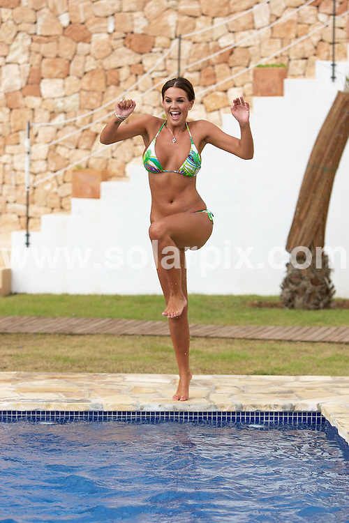 **ALL ROUND EXCLUSIVE PICTURES FROM SOLARPIX.COM**.**WORLDWIDE SYNDICATION RIGHTS**.**STRICTLY NO PUBLICATION ALLOWED IN ZOO MAGAZINE UK**.PIctures show model Danielle Lloyd soaking up the Spanish sun on holiday in Ibiza..JOB REF: 7141         AB1/SF       DATE:12.09.08.**MUST CREDIT SOLARPIX.COM OR DOUBLE FEE WILL BE CHARGED* *UNDER NO CIRCUMSTANCES IS THIS IMAGE TO BE REPRODUCED FOR ANY ONLINE EDITION WITHOUT PRIOR PERMISSION*