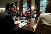 United States President Donald J. Trump listens to debates during a meeting on youth vaping and the electronic cigarette epidemic in the Cabinet Room at the White House in Washington on November 22, 2019.  Pictured with the President, left to right: Senior Counselor Kellyanne Conway, US Senator Mitt Romney (Republican of Utah), The President, and US Secretary of Health and Human Services (HHS) Alex Azar.<br /> Credit: Yuri Gripas / Pool via CNP