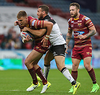 Huddersfield Giants's Alex Mellor is tackled by Widnes Vikings's Lloyd White<br /> <br /> Photographer Alex Dodd/CameraSport<br /> <br /> Betfred Super League Round 21  - Huddersfield Giants v Widnes Vikings - Friday 7th July 2017 - John Smith's Stadium - Huddersfield<br /> <br /> World Copyright &copy; 2017 CameraSport. All rights reserved. 43 Linden Ave. Countesthorpe. Leicester. England. LE8 5PG - Tel: +44 (0) 116 277 4147 - admin@camerasport.com - www.camerasport.com