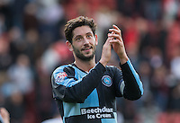 Joe Jacobson of Wycombe Wanderers applauds the supporters during the Sky Bet League 2 match between Leyton Orient and Wycombe Wanderers at the Matchroom Stadium, London, England on 19 September 2015. Photo by Andy Rowland.