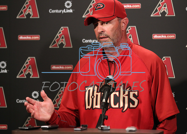 Manager Kirk Gibson answers media questions before a Cactus League preseason game between the San Francisco Giants and the Arizona Diamondbacks in Scottsdale, Ariz., on Sunday, March 4, 2012. .Photo by Cathleen Allison