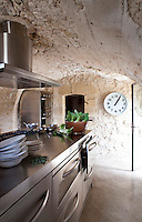 The rustic intimacy of this former stable creates an interesting environment for an industrial kitchen