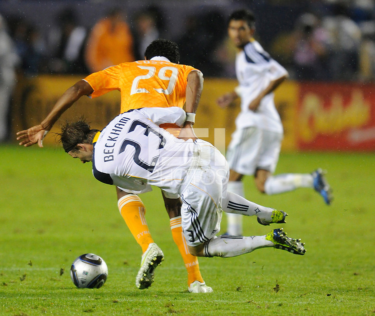 Los Angeles Galaxy's David Beckham gets a yellow card for pulling down Houston Dynamo's (29) Carlos Costly in the second half. The Galaxy won 1-0 in the MLS Cup at the Home Depot Center. Los Angeles Galaxy 1-0 over the Dynamo USA, Sunday, Nov. 20. 20011, in Carson, California. Photo by Matt A. Brown/isiphotos.com