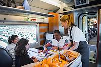 Spain, Costa Brava, Catalonia, Tossa de Mar. Renfe trains. On board staff serving breakfast. All modle released.