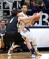 Justin Cobbs of California controls the ball away from Nate Tomlinson of Colorado during the game at Haas Pavilion in Berkeley, California on January 12th, 2012.   California defeated Colorado, 57-50.