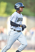 Augusta GreenJackets second baseman Jalen Miller (5) runs to first base during a game against the Asheville Tourists at McCormick Field on August 5, 2016 in Asheville, North Carolina. The Tourists defeated the GreenJackets 7-6. (Tony Farlow/Four Seam Images)