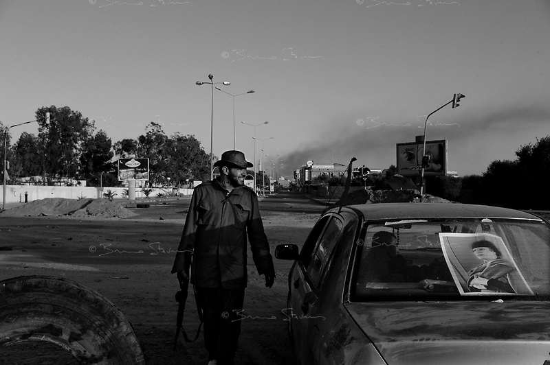 Misrata, Libya, March 27, 2011..Picture taken during a Libyan government organized trip to the besieged city of Misrata, about 200km east of Tripoli. The journalists were taken to a roundabout, approximately 2,5km south of the city center; nothwistanding the victory declarations of the government, violent gunfire soon erupted and journalists hastily ushered away, as well as the participants to the usual staged 'spontaneous' demonstration in support of the regime by imported supporters..