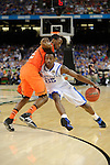 31 MAR 2012: Guard Marquis Teague (22) from the University of Kentucky tries to drive past guard Russ Smith (2) from the University of Louisville during the Semifinal Game of the 2012 NCAA Men's Division I Basketball Championship Final Four held at the Mercedes-Benz Superdome hosted by Tulane University in New Orleans, LA. Ryan McKeee/ NCAA Photos.