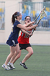 Santa Barbara, CA 02/18/12 - unidentified Michigan player(s) and Michele Manis (Georgia #11) in action during the Georgia-Michigan matchup at the 2012 Santa Barbara Shootout.  Georgia defeated Michigan 12-10.