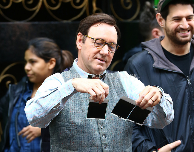WWW.ACEPIXS.COM<br /> <br /> May 11 2016, New York City<br /> <br /> Actor Kevin Spacey takes pictures on a Poloroid camera on the set of the new movie 'Rebel in The Rye' on May 11 2016 in New York City<br /> <br /> By Line: Zelig Shaul/ACE Pictures<br /> <br /> <br /> ACE Pictures, Inc.<br /> tel: 646 769 0430<br /> Email: info@acepixs.com<br /> www.acepixs.com