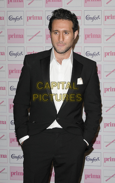ANTONY COSTA .Comfort Prima High Street Fashion Awards 2010 at Battersea Evolution, London, England, September 9th 2010 half length black suit white shirt beard facial hair hands in pockets tongue funny .CAP/CAN.©Can Nguyen/Capital Pictures.