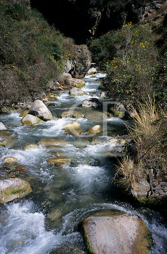 Inca Trail, Peru. Cusichaca river as a bubbling stream with white water and rounded boulders.