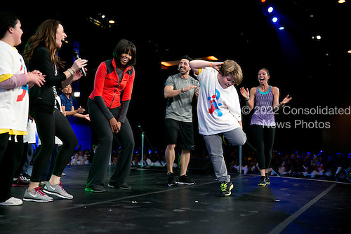 """First Lady Michelle Obama participates in a """"Let's Move! Active Schools"""" event with athletes and students at McCormick Place in Chicago, Illinois, February 28, 2013. .Mandatory Credit: Lawrence Jackson - White House via CNP"""