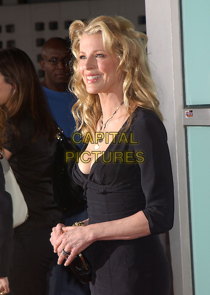 "KIM BASINGER.New Line Cinema's World Premiere of ""Cellular"" held at The Cinerama Dome in Hollywood, California .September 9, 2004.half length, black top, plunging neckline.www.capitalpictures.com.sales@capitalpictures.com.Copyright by Debbie VanStory."