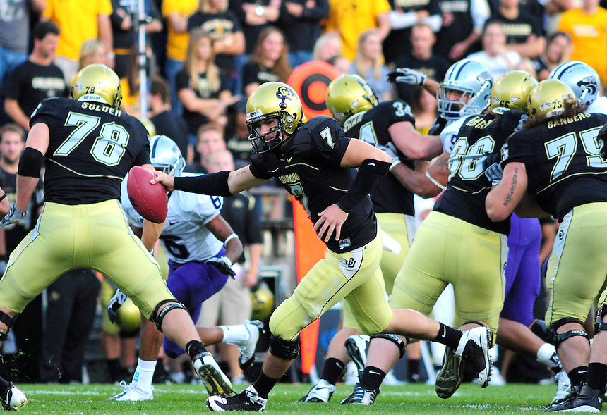18 October 08: Colorado quarterback Cody Hawkins scrambles and looks to hand off during a game against Kansas State. The Colorado Buffaloes defeated the Kansas State Wildcats 14-13 at Folsom Field in Boulder, Colorado.