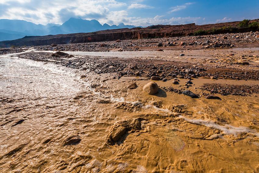 Crossing over a flood plain, Dana Biosphere Reserve, Wadi Feynan, Jordan.