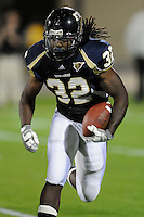 6 December 2008:  FIU running back Julian Reams (32) looks for a way into the end zone in the first quarter of the FIU 27-3 victory over Western Kentucky at FIU Stadium in Miami, Florida.
