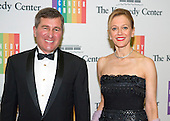 Ambassador Charles H. Rivkin and Susan Tolson arrive for the formal Artist's Dinner honoring the recipients of the 2014 Kennedy Center Honors hosted by United States Secretary of State John F. Kerry at the U.S. Department of State in Washington, D.C. on Saturday, December 6, 2014. The 2014 honorees are: singer Al Green, actor and filmmaker Tom Hanks, ballerina Patricia McBride, singer-songwriter Sting, and comedienne Lily Tomlin.<br /> Credit: Ron Sachs / Pool via CNP