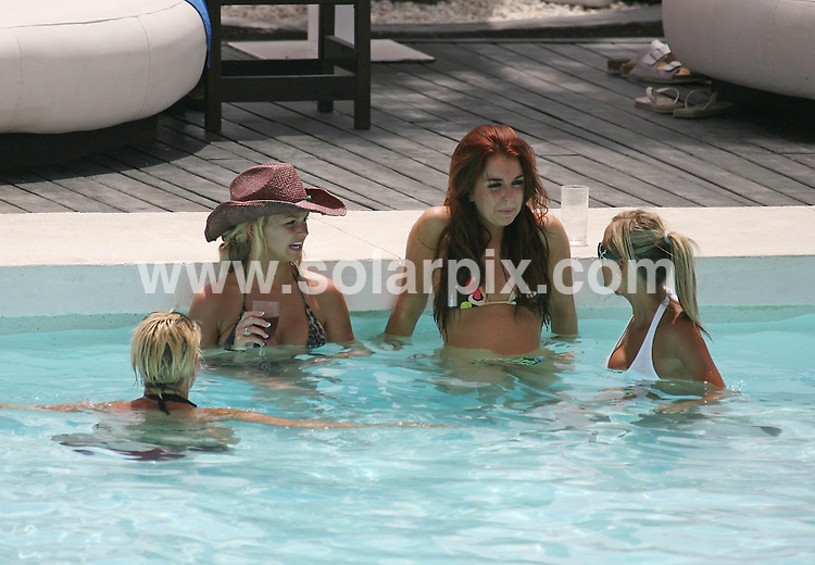 **ALL ROUND PICTURES FROM SOLARPIX.COM**.**WORLDWIDE SYNDICATION RIGHTS**.Jennifer Ellison relaxing by the pool in Marbella today with her little sister & friends...JOB REF:    4278    AB!    DATE:15.07.07.**MUST CREDIT SOLARPIX.COM OR DOUBLE FEE WILL BE CHARGED* *UNDER NO CIRCUMSTANCES IS THIS IMAGE TO BE REPRODUCED FOR ANY ONLINE EDITION WITHOUT PRIOR PERMISSION*