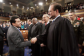 United States Attorney General Alberto R. Gonzales, left, stops to shake hands with newly appointed Associate Justice of the Supreme Court Samuel A. Alito, Jr., right, before the start of US President George W. Bush's State of the Union address to a joint session of  Congress, Wednesday, January 31, 2006 in Washington, DC. Also in the photo are from left to right, Chief Justice of the United States John G. Roberts, Jr., Associate Justice of the Supreme Court Clarence Thomas, Associate Justice of the Supreme Court Stephen G. Breyer, and the Chairman of the Joint Chiefs of Staff US Marine Corps General Peter Pace. <br /> Credit: Pablo Martinez Monsivais / Pool via CNP