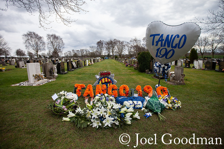 © Joel Goodman - 07973 332324 . 17/03/2012 . Staffordshire , UK . A balloon and floral tribute with PC Rathband's callsign - Tango 190 - left at the graveside . The funeral of former police officer David Rathband , at Stafford Crematorium . Rathband was found dead at his home in Blyth on 29th February 2012 . He was shot and blinded by killer Raoul Moat whilst he was on duty in the early hours of 4th July 2010 and went on to campaign for the Blue Lamp Foundation , which supports emergency staff injured in the line of duty , but he was reported to have never overcome the psychological impact of his injuries . Photo credit : Joel Goodman