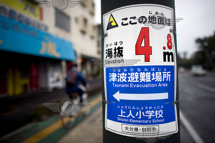 A warning sign indicating a Tsunami Evacuation Area. /Felix Features