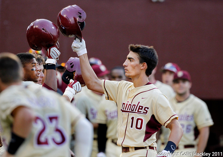 TALLAHASSEE, FL 10-FSU-TAMUBASE11 CH-Florida State's Justin Gonzalez, right, celebrates his homers and two RBIs in the sixth inning against Texas A&M Sunday at Dick Howser Stadium during NCAA Super Regional action in Tallahassee. The Seminoles beat the Aggies 23-9 to stay alive in the best of three series...COLIN HACKLEY PHOTO