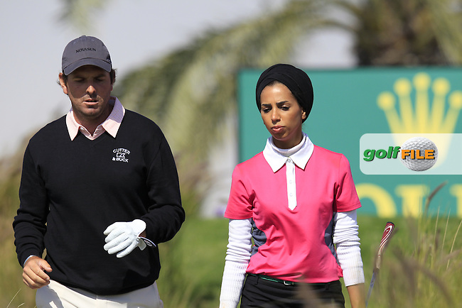 Thomas Aiken (RSA) and Yasmine al-Sharshani (QAT) during Wednesday's Pro-Am day of the 2015 Commercial Bank Qatar Masters, Doha Golf Club, Doha, Qatar.: Picture Eoin Clarke, www.golffile.ie: 1/20/2015