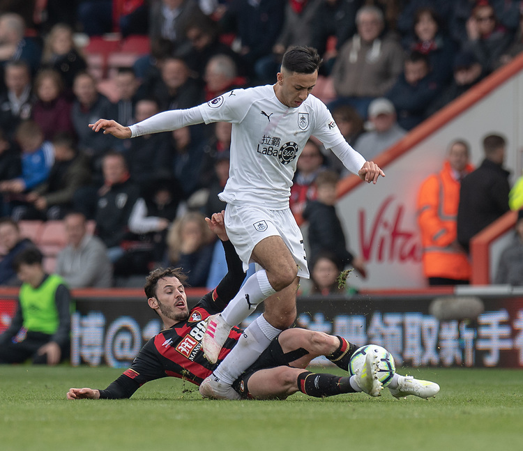 Burnley's Dwight McNeil (right) is tackled by Bournemouth's Adam Smith (left) <br /> <br /> Photographer David Horton/CameraSport<br /> <br /> The Premier League - Bournemouth v Burnley - Saturday 6th April 2019 - Vitality Stadium - Bournemouth<br /> <br /> World Copyright © 2019 CameraSport. All rights reserved. 43 Linden Ave. Countesthorpe. Leicester. England. LE8 5PG - Tel: +44 (0) 116 277 4147 - admin@camerasport.com - www.camerasport.com