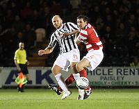 Sam Parkin closed down by Martin Canning in the St Mirren v Hamilton Academical Scottish Communities League Cup match played at St Mirren Park, Paisley on 25.9.12.