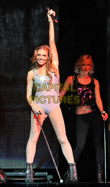 "ASHLYNE HUFF.Pop singer ASHLYNE HUFF performs as the opening act for the ""NKOTBSB TOUR 2011"" held at the Consol Energy Center, Pittsburgh, PA, USA..June 15th, 2011.stage concert live gig performance music full length blue leotard white boots cane dance dancing arm in air.CAP/ADM/JN.©Jason L Nelson/AdMedia/Capital Pictures."