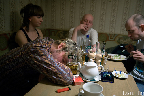 A Russian man falls asleep after drinking beer in Apartment 44, a hip bar on Bolshaya Nikitskaya street in Moscow. .Alcoholism is one of the main causes of death in Russia.