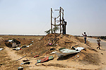Palestinians inspect damage at an observation post of the Islamic Jihad movement which was hit by Israeli tank fire earlier in the day that left two members killed, in Khan Younis in the southern Gaza strip on May 27, 2018.. Photo by Ashraf Amra