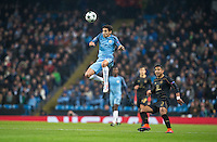 Jesus Navas of Manchester City heads forward as Emilio Izaguirre of Celtic looks on during the UEFA Champions League GROUP match between Manchester City and Celtic at the Etihad Stadium, Manchester, England on 6 December 2016. Photo by Andy Rowland.