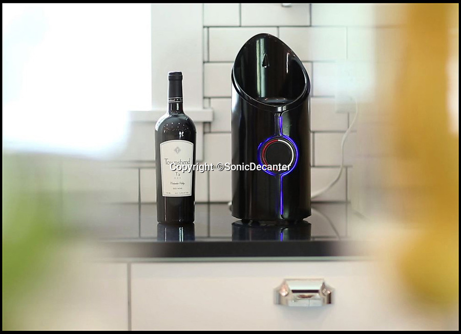 BNPS.co.uk (01202 558833)<br /> Pic: SonicDecanter/BNPS<br /> <br /> *Please use full byline*<br /> <br /> The decanter in the kitchen.<br /> <br /> This futuristic decanter is sending waves through the wine world - because it promises to transform cheap plonk into a much better and more expensive drink in a matter of minutes.<br /> <br /> The Sonic Decanter uses ultrasound to 'age' bargain bottles by altering the compounds in the wine to make it more drinkable.<br /> <br /> Its makers say the high frequency sound waves improve flavour by breaking down preservatives, softening tannins and releasing aromas not normally found in young wine.<br /> <br /> The launch of the Sonic Decanter is planned for June next year and it will cost buyers $249 - around £150.