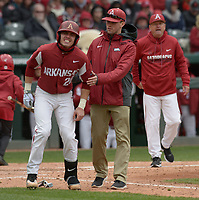 NWA Democrat-Gazette/ANDY SHUPE<br />Arkansas second baseman Carson Shaddy winces in pain after being hit by a pitch Saturday, April 14, 2018, as he is assisted by athletic trainer Corey Wood as coach Dave Van Horn walks to the plate during the sixth inning at Baum Stadium. Visit nwadg.com/photos to see more photographs from the game.