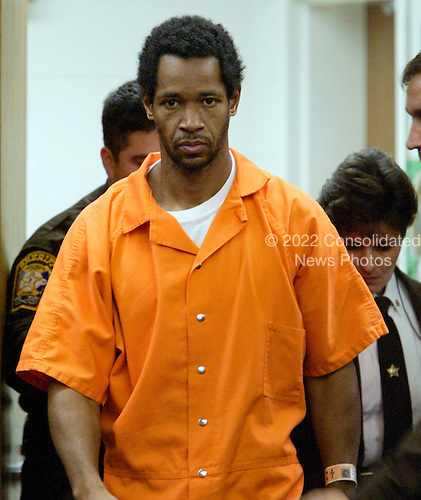 Manassas, VA - November 13, 2002 -- John Allen Muhammad arrives in the Prince William Circuit Court, to appear before Judge Leroy F. Millette for an hearing to appoint council where he is charged with the October 9, 2002 slaying of Dean Meyers in Manassas, Virginia, Wednesday November 13, 2002.  .Credit: Jahi Chikwendiu - Pool via CNP