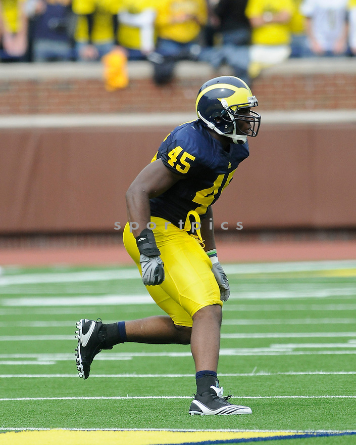 OBI EZEH, of the University of Michigan, in action during the MICHIGAN game against UMass on September 18, 2010 in Ann Arbor, Michigan...Michigan wins 42-37..SportPics