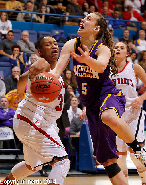 SIOUX FALLS, SD - MARCH 9:  Ashley Luke #5 from Western Illinois has the ball knocked out of her hands by Polly Harrington #33 from the University of South Dakota in the second half of their semifinal game at the 2014 Summit League Tournament in Sioux Falls, SD.  (Photo by Dave Eggen/Inertia)