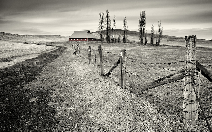 A muted red barn as might be seen in a dream.
