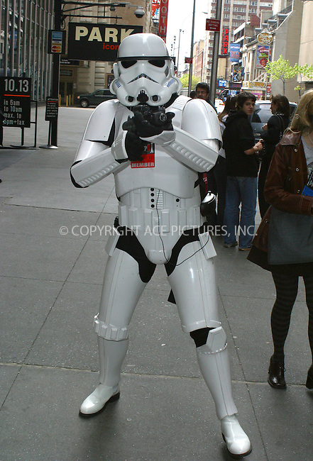 WWW.ACEPIXS.COM . . . . .  ....NEW YORK, MAY 2, 2005....In anticipation of the new Star Wars movie and Hayden Christensen appearing on MTV's TRL, a lone Storm Trooper invades Times Square.....Please byline: PAUL CUNNINGHAM - ACE PICTURES.... *** ***..Ace Pictures, Inc:  ..Craig Ashby (212) 243-8787..e-mail: picturedesk@acepixs.com..web: http://www.acepixs.com
