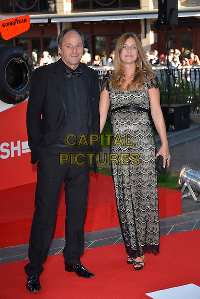Gerhard Berger &amp; Ana Corvo<br /> 'Rush' world film premiere at the Odeon Leicester Square cinema, London, England.<br /> 2nd September 2013<br /> full length black suit lace dress married husband wife <br /> CAP/PL<br /> &copy;Phil Loftus/Capital Pictures
