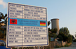 Korca/Korce-Albania - August 02, 2004---Sign/board at the entrance of the city of Korca to inform on the Albanian-German Collaboration/Cooperation (KfW) for the water supply and sewerage rehabilitation, a completed project; region/village of project implementation by GTZ-Wiram-Albania (German Technical Cooperation, Deutsche Gesellschaft fuer Technische Zusammenarbeit (GTZ) GmbH); infrastructure---Photo: Horst Wagner/eup-images